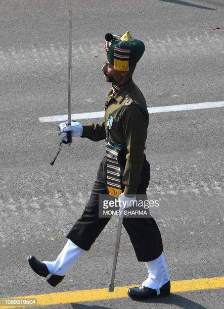 An Indian army officer leads their contingent during the Republic Day parade in New Delhi on January 26 2019 India celebrated its 70th Republic Day