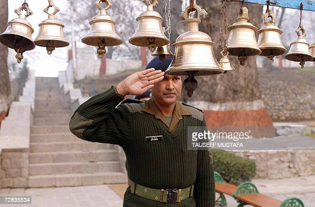 An Indian army officer prays at a temple before paying tribute to the Indian soldiers who died in the 1971 war against Pakistan which led to the...