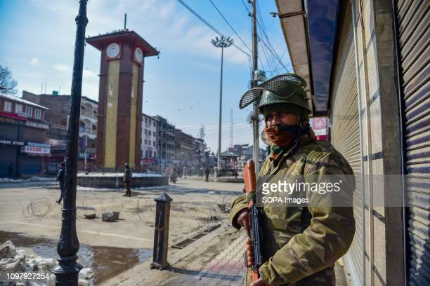 SRINAGAR KASHMIR INDIA SRINAGAR JAMMU KASHMIR INDIA An Indian army officer seen standing on guard near the clock tower during the restrictions at...