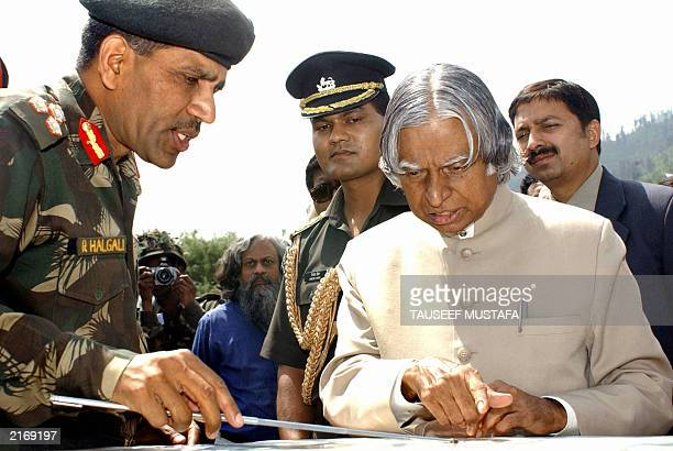 An Indian army officer shows a map of the Line of Control to Indian President APJ Abdul Kalam in Uri 28 June 2003 some 102 kms north of Srinagar...