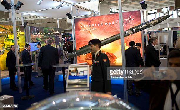 An Indian Army officer with the Ministry of Defense walks in front of a Lockheed Martin missile system February 18 2008 in New Delhi India The four...