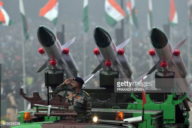 An Indian Army personnel salutes from a Akash Rocket Launcher vehicle during India's 69th Republic Day Parade in New Delhi on January 26 2018 India...