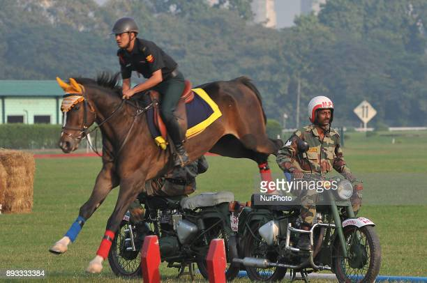 An Indian army soldier demonstrates his skills with his horse during the Vijay Diwas a ceremony to celebrate the liberation of Bangladesh by the...