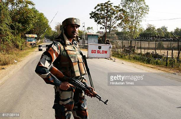 An Indian Army soldier on guard in front of the army camp which was attacked by the militants on October 3 2016 in Baramulla some 50 kilometers north...