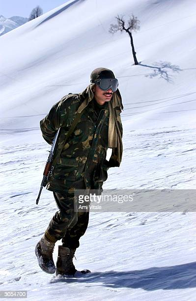 An Indian Army soldier patrols near ski slopes where India's national winter ski championships were held in Kongdoori March 7 2004 in Kashmir India...