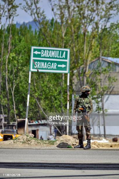 An Indian army soldier seen standing on guard on a main National Highway on the outskirts of Srinagar, Kashmir. The government has prohibited the...