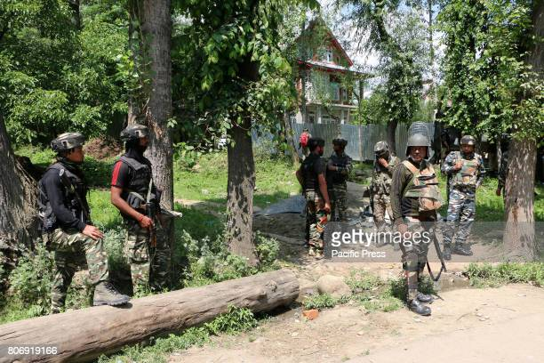 BAMNOO PULWAMA JAMMU KASHMIR INDIA An Indian army soldier stands alert near the encounter at Bamnoo area of South Kashmir's Pulwama Two Hizb rebels...