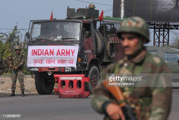 An Indian army soldier stands guard during a curfew in Jammu on February 18 2019 Indian authorities withdrew police protection for five separatist...