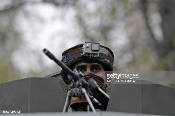 TOPSHOT An Indian army soldiers looks on during a cordon and search operation for suspected militants in Shuhama on the outskirts of Srinagar on...