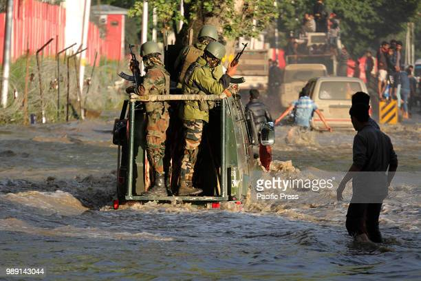 An Indian army vehicle moves through the flooded road in Srinagar the summer capital of Indian controlled Kashmir on June 30 2018The valley has seen...
