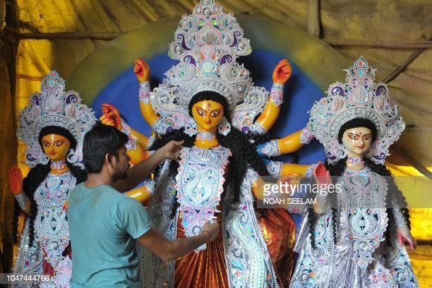 An Indian artist decorates statue of the Hindu goddess Durga at a workshop ahead the forthcoming DushheraVijaya Dashami festival in Hyderabad on...