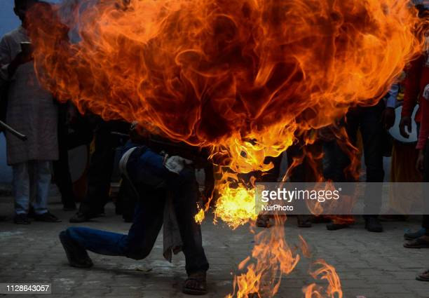 An indian artist demonstrates his fire skills during the religious procession of Maha ShivaRatri festivalcelebrated in reverence of the God...
