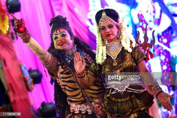 An Indian artist dressed as Hindu god Lord Shiva performs during a Navratri Festival Celebrations in Ajmer India on 3 October 2019