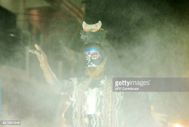 An Indian artist dressed as Hindu god Lord Shiva performs during a religious procession to mark Ravan ki Barat in Allahabad on September 16 ahead of...