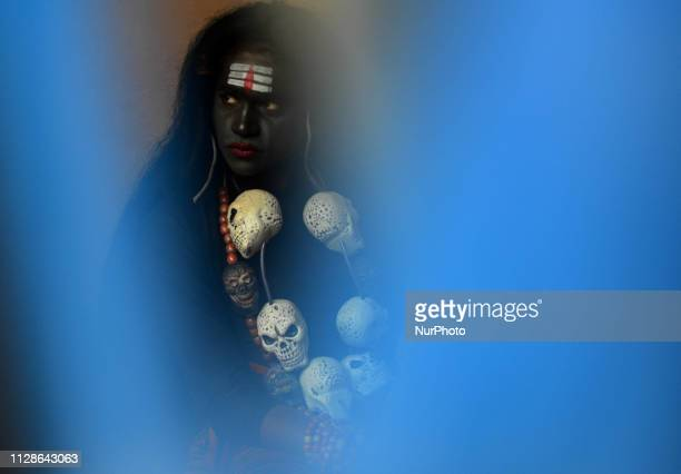 An indian artist dressed as hindu God Shiva performs during Maha ShivaRatri festivalcelebrated in reverence of the God Shivamarried to Hindu Goddess...
