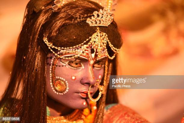 An Indian artist dressed as Hindu Goddess Kali perform Ramleela a drama based on Lord Rama's Life during Dussehra festival celebration