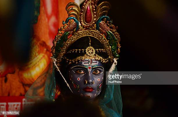 An Indian artist dressed as Hindu Goddess Kali performs the traditional 'Kali Swang' organised annually by the Daraganj Ramleela committee during...
