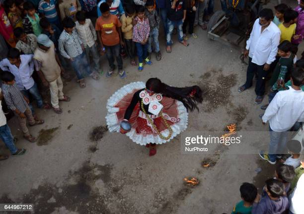 An indian artist dressed as hindu Goddess Shaktiperforms during Maha Shivaratri festival celebrated in reverence of the God Shivamarried to hindu...