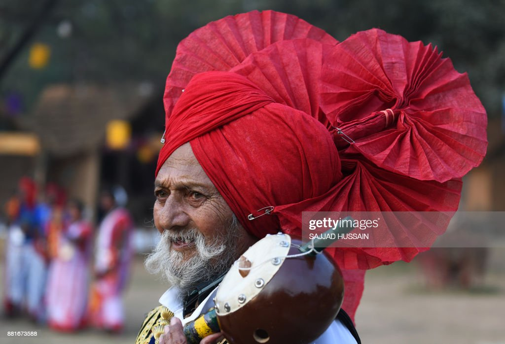 An Indian artist from the northern state of Punjab performs in a cultural event organised by Indira Gandhi National Centre for Arts in New Delhi on...