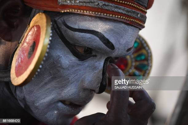 An Indian artist from the southern state of Kerala gets ready backstage before performing in an cultural event organised by Indira Gandhi National...