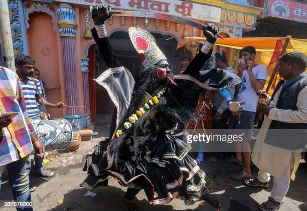 TOPSHOT An Indian artist performs as the Hindu deity 'Kali' during a procession to mark the Ram Navami festival in Bhopal on March 25 2018 Rama...