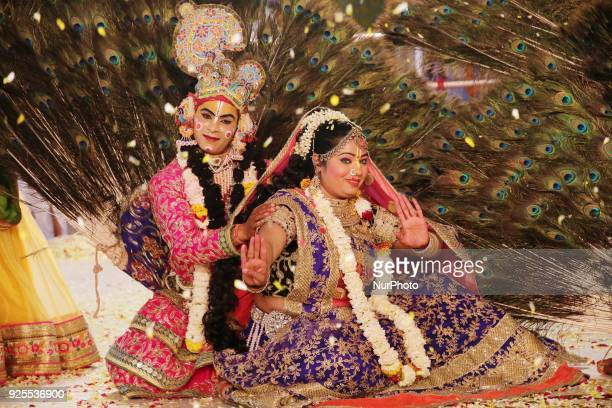 An Indian artists dressed as Lord Krishna and Radha perform during 'Fag Mahotsav' celebration at historical Govind Dev Ji temple ahead the Holi...