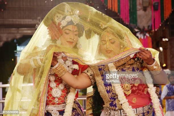 An Indian artists dressed as Lord Krishna and Radha perform during 'Fag Mahotsav' celebration at historical Govind Dev Ji temple ahead the Holi...