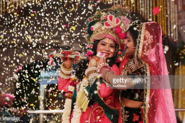 An Indian artists dressed as Lord Krishna and Radha play with flowers during 'Fag Mahotsav' celebration at historical Govind Dev Ji temple ahead the...