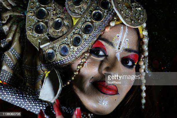 An Indian artists dressed as Lord Krishna performs during the Gangaur festival in Ajmer Rajasthan India on 17 April 2019 Gangaur festival is...