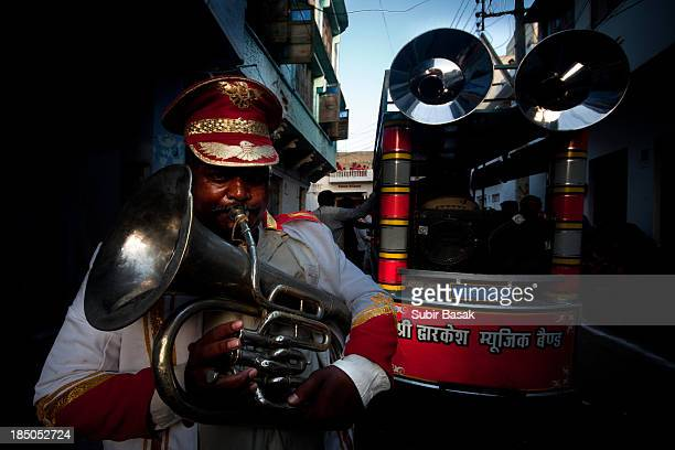 CONTENT] An Indian band musician plays his trumpet during Gangaur festival in UdaipurRajastanIndia on March 15 2012 GangaurOne of the most important...