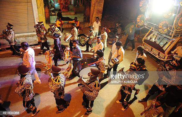 An Indian band performs during a 'Ravan ki Barat' procession held to mark the forthcoming Dussehra festival in Allahabad on October 8 2015 AFP PHOTO...
