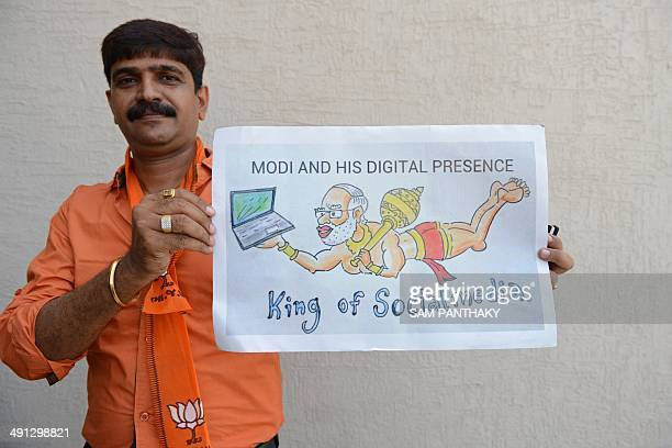 An Indian Bharatiya Janata Party supporter holds up a placard depicting BJP's prime ministerial candidate Narendra Modi as Hindu god Lord Hanuman at...