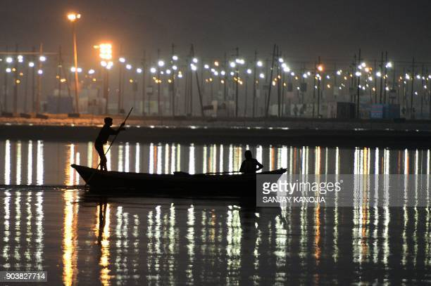 TOPSHOT An Indian boatman rows to tie up his boat at Sangam during the annual Magh Mela in Allahabad on January 11 2018 / AFP PHOTO / SANJAY KANOJIA