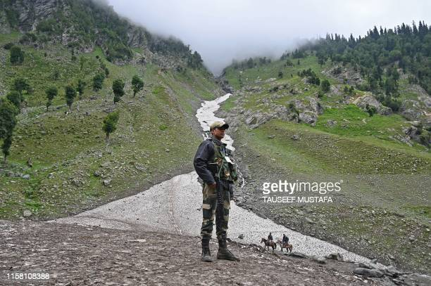 TOPSHOT An Indian Border Security Force soldier stands guard on a glacier at Chandanwari some 115 km southeast of Srinagar during the annual Hindu...