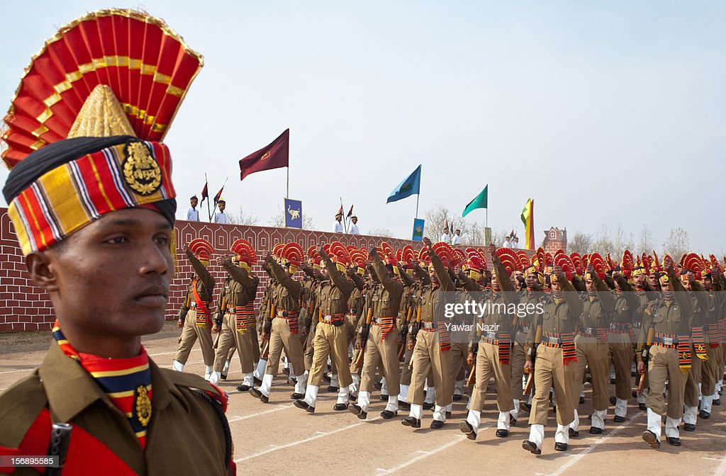 An Indian Border Security Force (BSF) soldier stands in formation as others march during their passing out parade on November 24, 2012 in Humhama, on the outskirts of Srinagar, the summer capital of Indian administered Kashmir, India. 545 new trained recruits of the Indian paramilitary Border Security Force constables took oaths during their passing out parade after successfully completing 36 weeks of basic training which involved physical fitness, weapons handling, map reading, counter-insurgency operations and human rights. The recruits will join Indian soldiers to fight militants in Kashmir, a spokesman of the paramilitary BSF said. India has already close to a million soldiers posted in Jammu and Kashmir, making the disputed Himalayan region one of the most militarized zone in the world