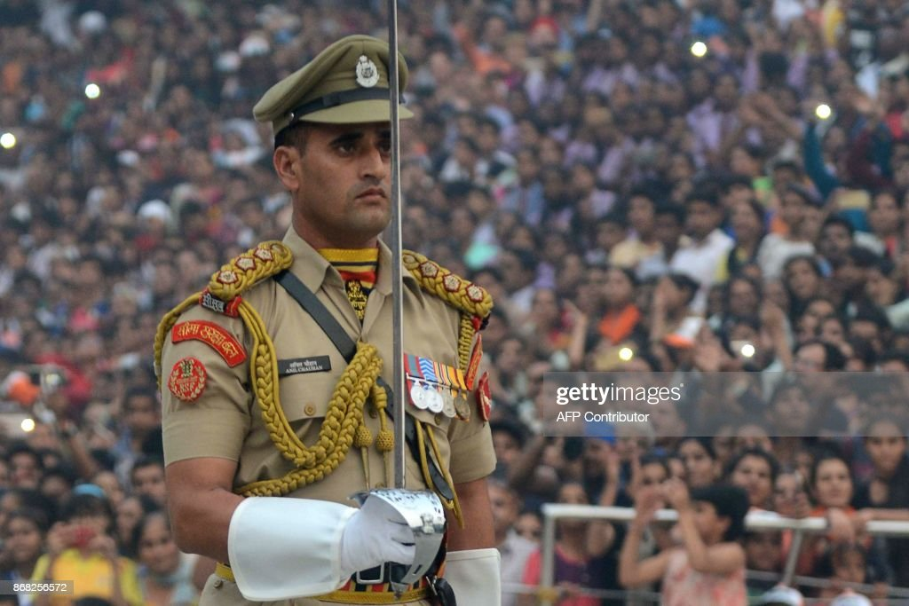 An Indian Border Security Force soldier takes part in the daily beating of the retreat ceremony at the IndiaPakistan Wagah Border Post some 35kms...