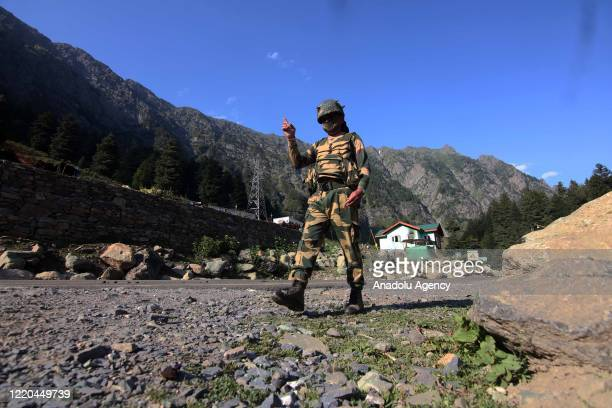 An Indian Border Security Force soldier walks near a check post along the SrinagarLeh National highway on June 16 2020 During the deescalation...