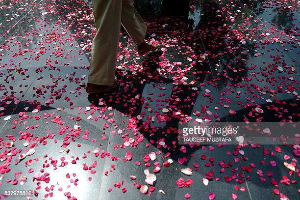 TOPSHOT An Indian Border Security Force soldier walks over rose petals at a memorial for those killed in conflict following a wreathlaying ceremony...