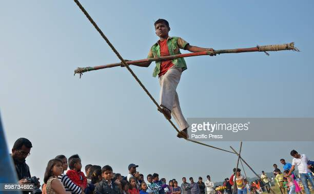 An Indian boy performs on the rope to earn his bread