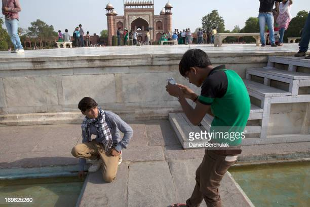 An Indian boy poses for a photograph at the Taj Mahal on May 29 2013 in Agra India Completed in 1643 the mausoleum was built by the Mughal emperor...