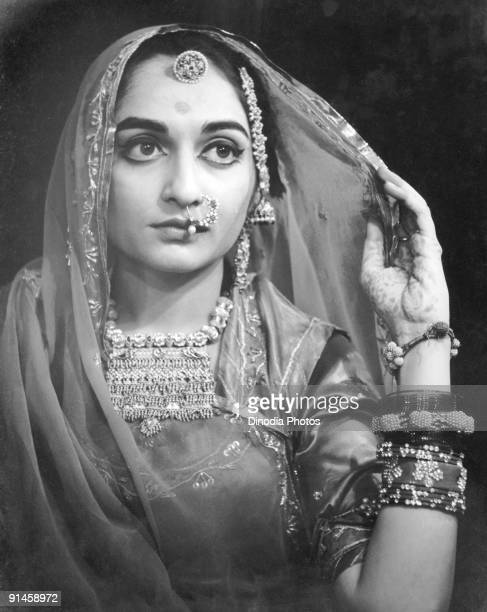 An Indian bride in Rajasthan 1940s Her hand is decorated with mehndi a temporary henna tattoo