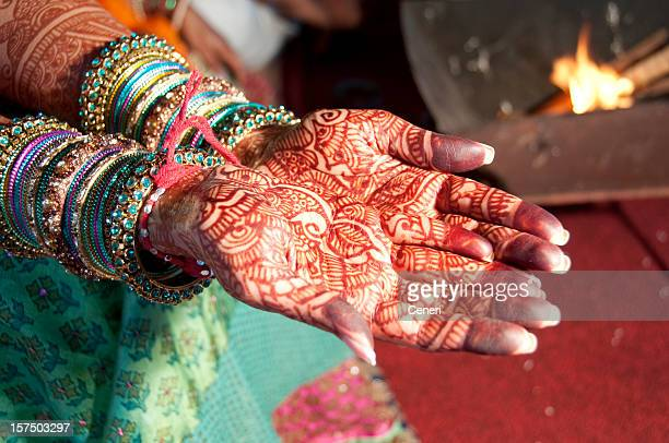 An Indian bride with hands full of henna