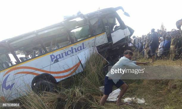 An Indian bus is pulled from the Banas River after a deadly accident in Sawai Madhopur some 160 kilometres from Jaipur in Rajasthan state on December...