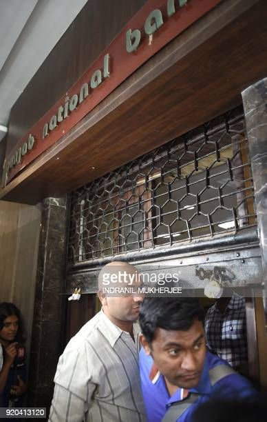 An Indian Central Bureau of Investigation official comes out of the Brady House branch of the Punjab National Bank which had been sealed earlier in...