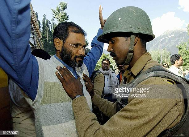 An Indian Central Reserve Police Force soldier frisks a Hindu pilgrim near the village of Chandanwari some 114 kms south of Srinagar, 15 July 2004,...