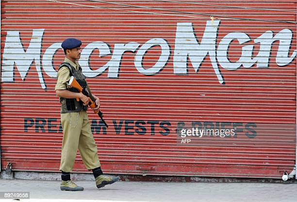 An Indian Central Reserve Police Force soldier patrols a deserted street during a strike in Srinagar on July 25 2009 The strike called by the...