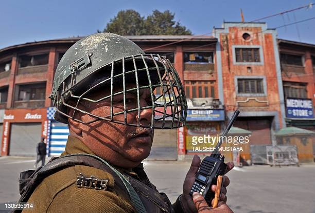 An Indian Central Reserve Police Force soldier patrols during a one-day strike in Srinagar on October 27, 2011. Separatists observe October 27 as a...