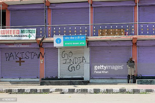 CONTENT] An Indian central reserve police force soldier stands alert in cufew hit old city SrinagarKashmirA strict curfew was inposed by Indian...