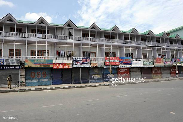 An Indian Central Reserve Police Force soldier stands guard on a deserted street during a strike in Srinagar on July 25 2009 The strike called by the...