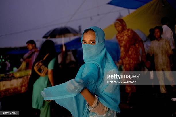 An Indian child begs for alms outside Jama Masjid during Iftar the breaking of the Ramadan fast on Chand Raat the last evening of the holy Islamic...